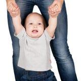 母亲抱着从手的婴孩 库存照片