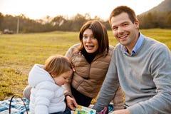 母亲父亲和他们的小女儿 图库摄影