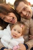 母亲父亲和他们的小女儿 库存照片