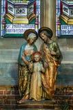 母亲玛丽,孩子耶稣和约瑟夫雕象  库存照片