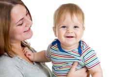 母亲藏品在白色查出的男婴 免版税库存照片