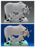 母牛和小牛雕象。 库存图片
