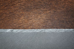 母牛皮肤和石头 免版税库存图片