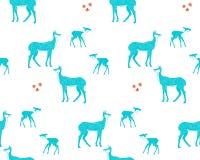 母鹿、小鹿和花 免版税库存图片