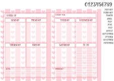 每周计划者书本大小尺寸模板在桃红色镶边背景的 库存照片