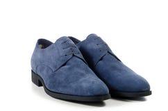 每天对蓝色人的鞋子 免版税库存图片