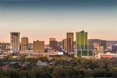 比勒陀利亚Tshwane,南非- 2016年4月17日, 市中心地平线日出视图  库存照片