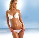比基尼泳装夫人性感的泳装佩带的年&# 免版税库存图片
