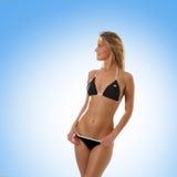 比基尼泳装夫人性感的泳装佩带的年&# 免版税图库摄影