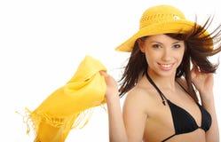 比基尼泳装女孩帽子性感的黄色 库存照片