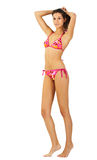 比基尼泳装女孩查出的高年轻人 免版税库存图片