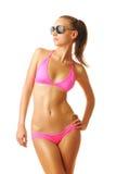 比基尼泳装性感的棕褐色的妇女 免版税库存照片