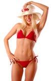 比基尼泳装白肤金发的红色妇女 库存照片