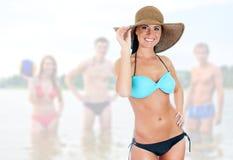比基尼泳装的俏丽的妇女 免版税库存照片