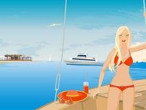 比基尼泳装的金发碧眼的女人 免版税库存图片