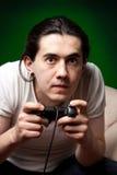 比赛供以人员演奏视频年轻人 免版税库存照片