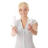 比较环境保护者女孩的电灯泡青少年 免版税库存照片