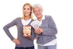 比较货币储蓄妇女 库存照片