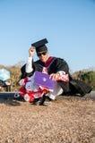 毕业亚洲人 免版税库存照片