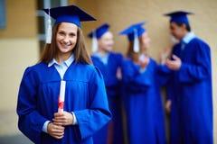 毕业女孩 免版税库存图片