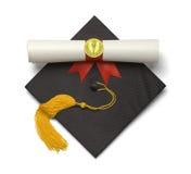 毕业帽子火炬纸卷 免版税库存照片