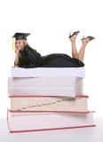 毕业生俏丽的妇女 库存照片