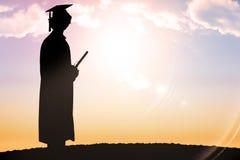 毕业生剪影的综合图象  免版税库存照片