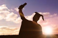 毕业生剪影的综合图象  库存图片