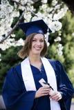 毕业生微笑 免版税库存照片