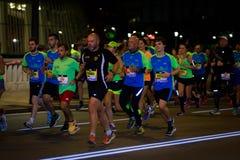 毕尔巴鄂,西班牙- 10月22 :未认出的赛跑者在毕尔巴鄂马拉松夜,庆祝在2016年10月22日的毕尔巴鄂 库存图片