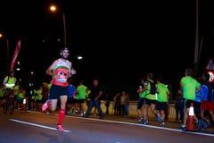 毕尔巴鄂,西班牙- 10月22 :未认出的赛跑者以伤残在毕尔巴鄂马拉松夜,庆祝在10月2日的毕尔巴鄂 库存照片