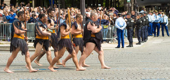 毛利人战士参加巴士底日军事游行, 免版税库存图片