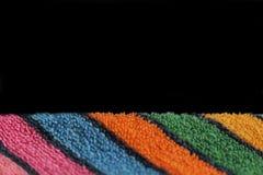 毛巾的多彩多姿的软的特里织品在文本长方形的黑背景空间 免版税库存照片