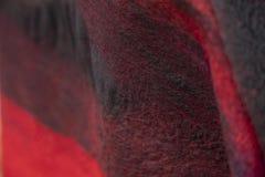 毛毡的背景装饰是黑红色 免版税库存图片