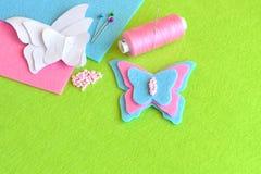 毛毡蝴蝶,纸模板,螺纹,针,别针,小珠 缝合的集合,讲解 库存图片