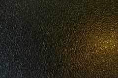 毛玻璃纹理黑色和金背景 免版税库存照片