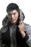 毛皮的亚裔人和毛线构造夹克 免版税库存照片