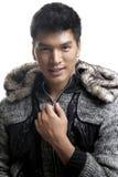 毛皮的亚裔人和毛线构造夹克 库存图片