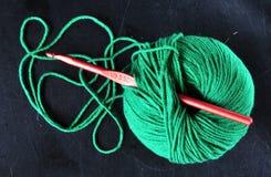 毛线球在绿色的 免版税库存照片