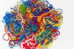 毛线的抽象样式,颜色穿线在白色隔绝的束 免版税图库摄影