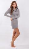 毛线衣礼服的妇女 免版税图库摄影