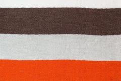 毛线衣螺纹纹理背景,毛纱多色前面圈编织了背景 免版税库存图片
