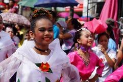 民族服装的女性狂欢节舞蹈家凝视照相机 库存照片