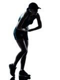 气喘吁吁的慢跑者赛跑者疲乏的妇女 免版税图库摄影