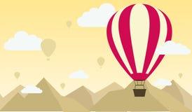 气球有山场面背景 免版税库存照片