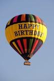 气球生日愉快的热乘驾 库存图片