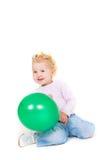 气球逗人喜爱的女孩绿色小孩 库存图片