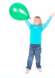 气球逗人喜爱的女孩绿色 免版税库存照片