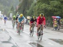 细气管球骑马在雨-环法自行车赛中2014年 库存图片