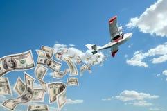 水上飞机和美元 库存图片